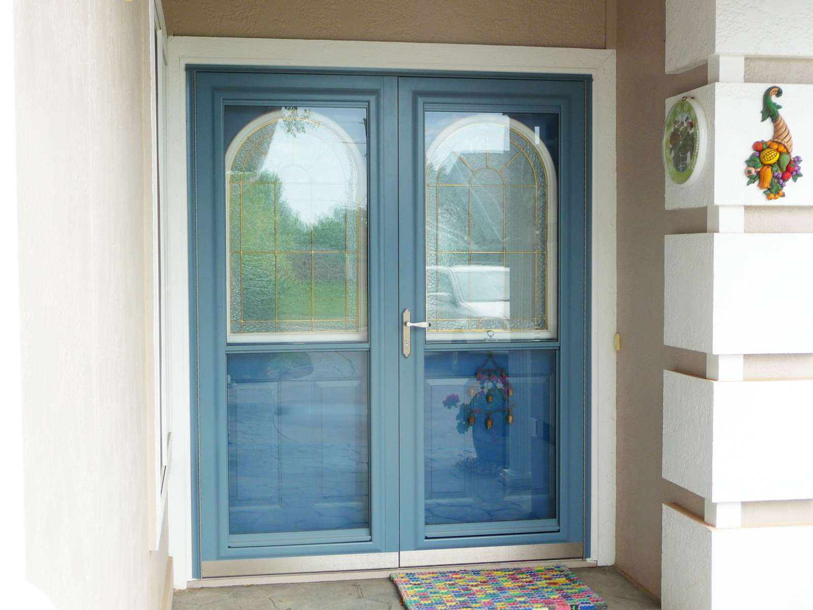Double storm doors we replaced the double entry doors with for Double storm doors for french doors